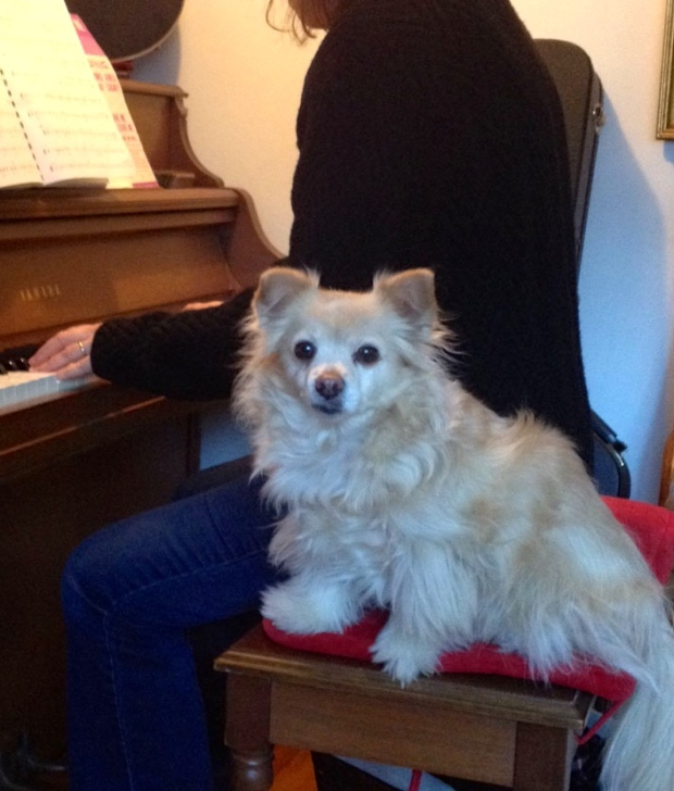 Frances on piano bench